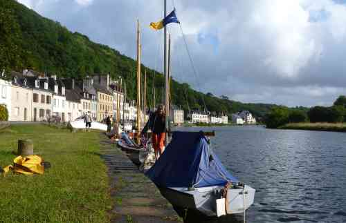 Our boat at the quayside at Port Launay - when moored like this we need to adjust our mooring lines so that the boat tent does not chafe on the quay wall